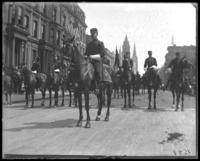 Brigadier-General McCloskey Butt and staff riding in a Decoration Day parade on Fifth Avenue, New York City, 1900.