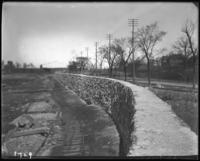 Reservoir excavation and wall during the construction of Jerome Park, Bronx, N.Y., undated [c. 1905-1906].