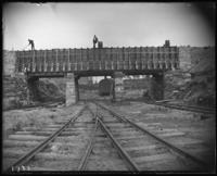 Railroad tracks and the  temporary conduit for the old aqueduct, during the construction of Jerome Park, Bronx, N.Y., undated [c. 1905-1906]