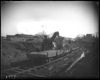 Steam shovel and workmen during the construction of Jerome Park, Bronx, N.Y., undated [c. 1905-1906].