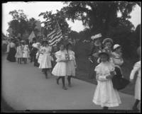 Children waving flags, Sunday Schools parade in Claremont Park, Bronx, N.Y., June 6, 1903.