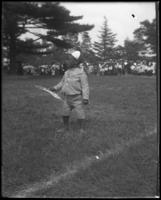 Unidentified African American boy with a flag, Sunday Schools parade in Claremont Park, Bronx, N.Y.,  June 6, 1903.