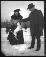 Unidentified man and woman with a dog on the ice, Van Cortlandt Lake, Van Cortlandt Park, Bronx, N.Y., undated [February 1902?].