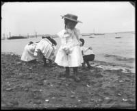 Willie Stonebridge and other unidentified children playing on the beach, Lohbauer Park, Throggs Neck, Pelham Bay, Bronx, N.Y., 1898.