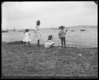 Grace and Willie Stonebridge  with a unidentified little girl [Robin?] and boy playing on the beach, Lohbauer Park, Throggs Neck, Pelham Bay, Bronx, N.Y., 1898.