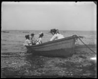 Grace and Willie Stonebridge  with a unidentified little girl [Robin?] and boy in a row boat on the beach, Lohbauer Park, Throggs Neck, Pelham Bay, Bronx, N.Y., 1898.