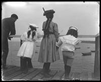 Unidentified children and man on a dock, Lohbauer Park, Throggs Neck, Pelham Bay, Bronx, N.Y., 1898.