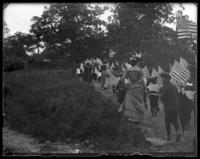 Children marching with American flags during the Sunday School May Walk, Bronx, N.Y. [?], 1898. Mrs. George E. Stonebridge in foreground.