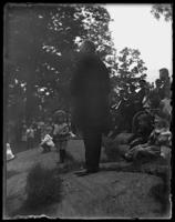 Unidentified man addressing a group in a park, Bronx, N.Y. [?], 1898.
