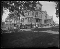 Children parading past houses during the Sunday School May Walk, Bronx, N.Y. [?], 1898.
