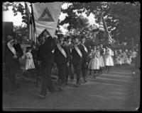 Children marching with American flags during the Sunday School May Walk, Bronx, N.Y. [?], 1898.