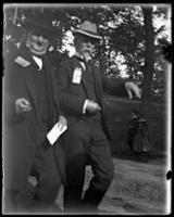 Two unidentified older men and two children at the Sunday School May Walk parade, Bronx, N.Y. [?], 1898.