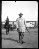 Unidentified man walking on the Speedway, New York City, undated [c. 1899-1904].
