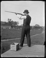 Unidentified man at a shooting range, Oak Point, Port Morris, Bronx, N.Y., undated [c. 1897-1905].