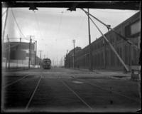 Trolley approaching a crossing, Oak Point, Port Morris, Bronx, N.Y., undated [c. 1897-1905].