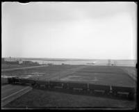 Unidentified empty land, Oak Point, Port Morris, Bronx, N.Y., undated [c. 1897-1905]. Brother Islands visible [?].