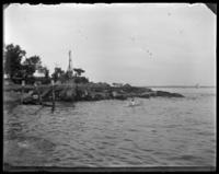 Unidentified boy swimming off a rocky point, Oak Point, Port Morris, Bronx, N.Y., undated [c. 1897-1905].