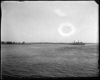 Steamboat passing the Brother Islands, Oak Point, Port Morris, Bronx, N.Y., undated [c. 1897-1905].