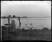 Mrs. Stonebridge with toddlers Grace and Willie on a rocky beach, Oak Point, Port Morris, Bronx, N.Y., undated [c. 1897-1905].