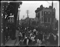 Crowds marching in the street for the unveiling of the Lorelei Fountain [Heinrich Heine Memorial], Bronx, N.Y., July 8, 1899.