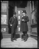 Two unidentified men in bowler and top hat outside a commercial property, Bronx, N.Y., undated [c. 1897-1917].