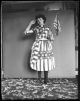Unidentified teenage girl dressed in a stars-and-stripes dress, Bronx, N.Y., undated [c. 1897-1917].