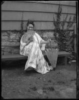 Daisy posing in a kimono with fan and parasol, Bronx, N.Y., undated [c. 1905-1910].