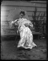 Daisy in a kimono with fan and parasol, Bronx, N.Y., undated [c. 1905-1910].