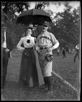 Unidentified couple at a baseball game, with the man in uniform,  Bronx, N.Y., undated [c. 1897-1917].