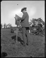 Captain Frank I. Stott of the 22nd Regiment keeping score, Creedmoor Rifle Range, Queens Village, Queens, N.Y., 1899.