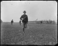 Captain Rudolph O. Haubald of the 22nd Regiment running, Creedmoor Rifle Range, Queens Village, Queens, N.Y., 1900.