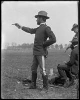 Captain Frederick Charles Ringer (22nd Regiment) firing his pistol, Creedmoor Rifle Range, Queens Village, Queens, N.Y., 1900.