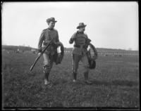 Two unidentified guardsmen from the 7th Regiment coming off the west range, Creedmoor Rifle Range, Queens Village, Queens, N.Y., May 11, 1901.