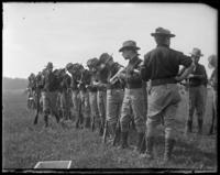 71st Regiment Company G, filling their belts, Creedmoor Rifle Range, Queens Village, Queens, N.Y., May 24, 1902.