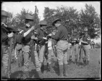 71st Regiment checking the locks, Creedmoor Rifle Range, Queens Village, Queens, N.Y., May 24, 1902.