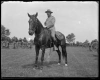 Capt. Rasquin of the 3rd Battery on horseback, Creedmoor Rifle Range, Queens Village, Queens, N.Y., June 28, 1902.