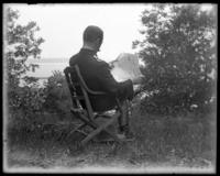Brigadier-General McCloskey Butt in a camp chair, [State Camp (Camp Smith), Peekskill, N.Y.?], undated [c. 1900].