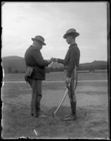 Captain David Wilson receiving a message, [State Camp (Camp Smith), Peekskill, N.Y.?], undated [c. June 19, 1900].