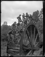 23rd Regiment soldiers posing for photographs on a mill wheel, State Camp (Camp Smith), Peekskill, N.Y., June 16, 1903.