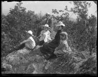 Bella, Grace, Willie, Georgie, and George E. Stonebridge  sitting on the mountain top, south rock, Garrison, N.Y., 1902.