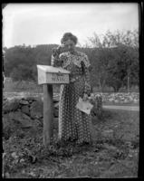 Daisy Robinson looking sad beside the mailbox ('Disappointment'), Garrison, N.Y., 1902.