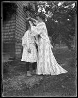Daisy in a 'kimono,' playing with Grace's hair, Garrison, N.Y., 1903.