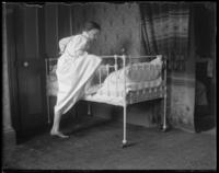 Grace Stonebridge getting into a bed, Bronx, N.Y., undated [c. 1900?].