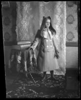 Grace Stonebridge in a coat with the hood up, Bronx, N.Y., undated [c. 1900?].