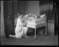 Bedtime, Grace teasing Willie with a feather, Bronx, N.Y., undated [c. 1900?].