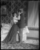 George E. Stonebridge and an unidentified woman embracing in a romantic tableau, Bronx, N.Y. [?], undated [c. 1903].