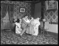 George E. Stonebridge and an unidentified woman embracing on a love seat in a romantic tableau, Bronx, N.Y. [?], undated [c. 1903].