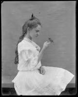 Grace Stonebridge holding a young bird on her finger, Bronx, N.Y., undated [c. 1903].