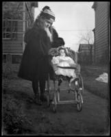 Grace Stonebridge with a doll carriage, Bronx, N.Y., undated [c. 1898].