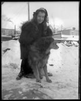 Grace Stonebridge with a dog in the snow, Bronx, N.Y., undated [c. 1898].